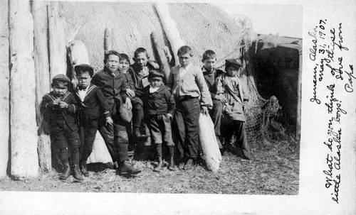 Russian and Native boys leaning up against a barabara, Karluk, Alaska, June 1906