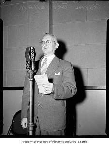 Royal Brougham at a KOMO and NBC radio microphone, Seattle, 1946